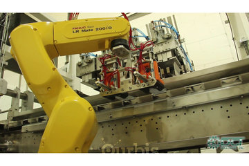 DGT Solutions Inc. à Lachine: High-speed Robotic Cartoner Machine
