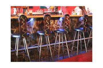 Gossamer Steel Custom Metal Work in Vancouver: Metal art on bar stools and bar facade