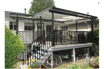 EconoWise Sunrooms & Patio Covers in Surrey: Re-sheathed deck; wide picket railings; roof mounted patio cover