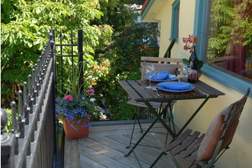 Mistiso's Place  Vacation Rentals in Nelson: Kokanee deck overlooking Kootenay Lake