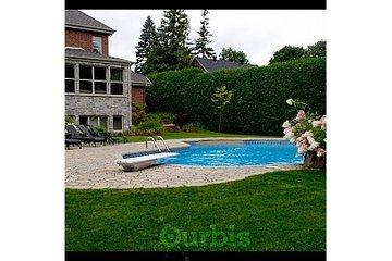 Amenagement-paysager-muret Terre en fleur à St-Eustache: piscine trottoir paysagiste