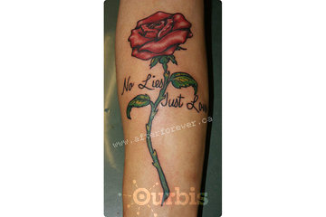 After Forever Tattoo & Laser Tattoo Removal in Swift Current: Miss Boy Clyde