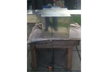 Gregs Metal Grinding in Oshawa: mirror finish on stainless steel tank