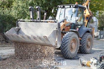 Excavations Robert Daunais in Granby: Épandeur à pierre et sable