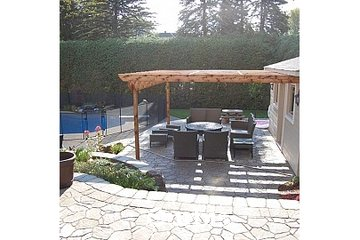 Amenagement-paysager-muret Terre en fleur à St-Eustache: aire de repos patio cour arrière